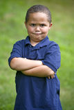 Angry boy. Young angry boy outside with folded arms stock images
