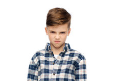 Angry boy in checkered shirt. Childhood, emotion, anger, hate and people concept - angry boy in checkered shirt royalty free stock image