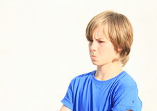Angry boy. Face of a little angry boy in blue t-shirt Stock Photography