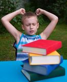 Angry boy hate reading Stock Images