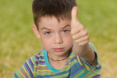 Angry boy with his thumb up Royalty Free Stock Photo