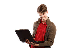 Angry boy looking at computer Royalty Free Stock Images