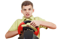 Angry Boy plays a driving game console, isolated on white Stock Photos
