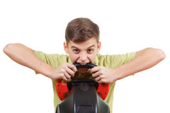 Angry Boy plays a driving game console, on white Stock Images