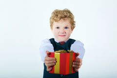 Angry boy  returns  gift. Holiday concept. Holiday failed Royalty Free Stock Image