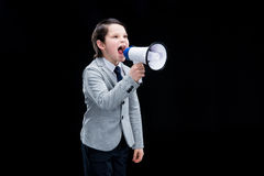 Angry Boy standing with megaphone and yelling Royalty Free Stock Photos