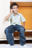 Angry boy talking to mobile phone Royalty Free Stock Photography