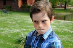 Angry  boy. Angry teenager boy looking bored Stock Photography
