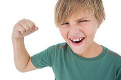 Angry boy tensing arm muscle. On white background Royalty Free Stock Photography