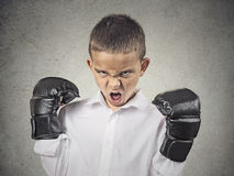 Angry boy wearing boxing gloves Royalty Free Stock Photography