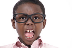 Angry boy yelling. Face closeup of an angry little boy yelling Royalty Free Stock Photos