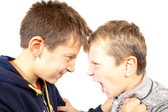 Angry boys. Portrait of two anger boys on white background Stock Photo