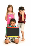 Angry Boys and Girl with Chalkboard. Angry boys and girl holding blank chalk board Stock Photos