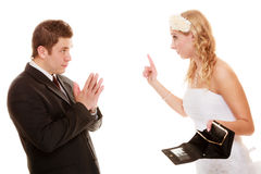 Angry bride with empty purse and groom quarrelling Stock Images