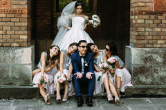 Angry bride and groom with the bridesmaids. A Stock Photos