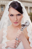 Angry bride holding wrench Royalty Free Stock Photography