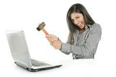 Angry brunette businesswoman with hammer stock photography