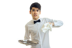 Angry brunette male waiter with tray in his hands Stock Photos