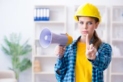 The angry building supervisor with megaphone Stock Photos