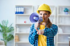The angry building supervisor with megaphone Royalty Free Stock Images