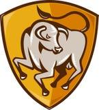 Angry bull attacking shield woodcut Stock Photo