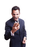 Angry bunsinessman yelling at his phone Royalty Free Stock Photography