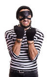 Angry burglar with handcuffs. Portrait isolated on white background Stock Images