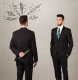 Angry business handshake concept Stock Photo