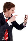 Angry business man Stock Image