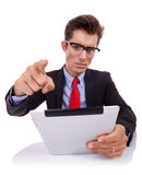 Angry business man acusing while reading pad Royalty Free Stock Image