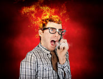 Angry business man engulfed in flames Royalty Free Stock Photo