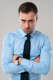 Angry business man with folded hands Royalty Free Stock Image