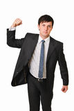 ANGRY BUSINESS MAN WITH HAND CLENCHED TO FIST. Angry businessman with hand clenched as fist. Studio shot taken against isolated white background. A picture of Royalty Free Stock Image