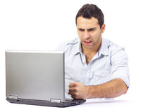 Angry business man at his laptop Royalty Free Stock Photography