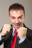 Angry business man holding his fists up Stock Photography