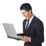 Angry business man holding laptop Royalty Free Stock Photos