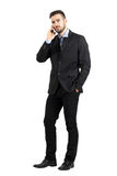 Angry business man on the phone looking at camera. Stock Photo