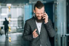 Angry business man phone scream failure loss. Angry furious business man talking on the phone and screaming. failure loss and frustration royalty free stock images