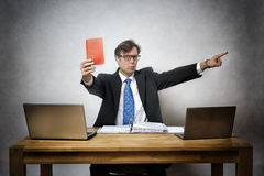Angry business man with red card Royalty Free Stock Image