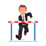 Angry business man running to a barrier obstacle Stock Photos
