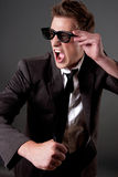 Angry business man with sun glasses Royalty Free Stock Photography