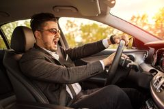 Angry business man driving and honking royalty free stock photo