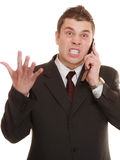 Angry business man talking on phone. Relationship difficulties. Angry man talking on mobile cell phone. Fury businessman screaming, negative facial expression Stock Images