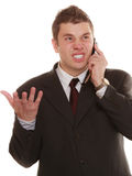 Angry business man talking on phone. Relationship difficulties. Angry man talking on mobile cell phone. Fury businessman screaming, negative facial expression Stock Photography