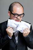 Angry business man tear paper off. With gray background Royalty Free Stock Photos