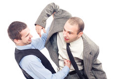 Angry business men fighting Royalty Free Stock Images