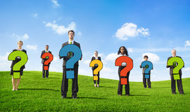Angry Business People Outdoors Holding Question Marks Royalty Free Stock Photography