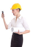 Angry business woman architect in yellow builder helmet shouting Stock Photography