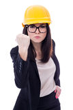 Angry business woman architect in yellow helmet showing her fist Royalty Free Stock Photography