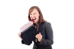 Angry business woman biting laptop Royalty Free Stock Photography
